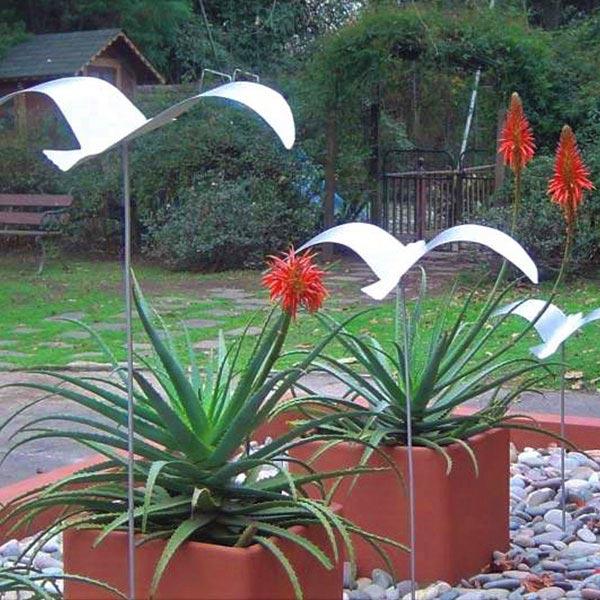 Esculturas, iluminación y mobiliario exterior